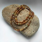 Алхимический нефрит: бусы на камне Триозерия