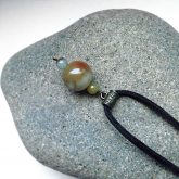 Алхимический нефрит: кулон на камне Триозерия